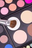 Make-up brushes on eyeshadows palettes — Stock Photo