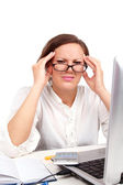 Tired businesswoman holding her head — Stock Photo