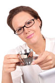 Businesswoman drinking a coffee, focus on hands — Foto Stock