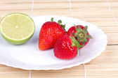 Strawberries and lime — Stock Photo