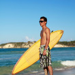 Surfer holding a surfboard — Stock Photo