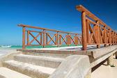 Wooden pier on caribbean beach — Stock Photo