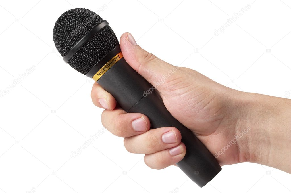 Microphone In Hand : Black microphone in the hand — stock photo grublee