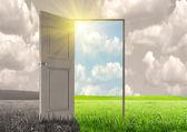 Sun rays and open door — Stock Photo