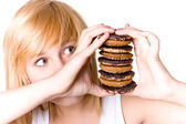 Young woman with cookies — Stock Photo