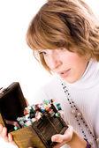 Beautiful girl looks at wooden jewelry box — Stock Photo
