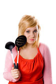 Young housewife with kitchen utensil — Stock Photo