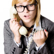 Stock Photo: Young businesswoman with phone