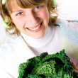 Beautiful woman with fresh savoy cabbage — Stock Photo