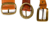 Three brown leather belts — Stock Photo