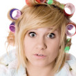 Stock Photo: Funny housewife with curlers