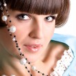 Stock Photo: Brunet womwith pearl beads