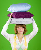 Woman with pillows stack — Stock Photo