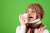Cold girl sneezes — Stock Photo