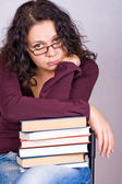 Woman with stack of books — Stock Photo