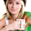 Girl in a cowboy hat with cup of tea — Stock Photo