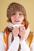 Cold girl sneezes — Stock Photo