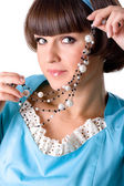Woman in blue dress with pearl beads — Stock Photo