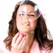 Pretty girl blowing soap bubbles — Stock Photo