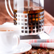French press and cup of fresh herbal tea - Stock Photo