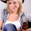 Western womwith bottle of whiskey — Stock Photo #4406422
