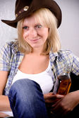 Western woman with bottle of whiskey — Stock Photo