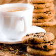 Cup of herbal tea and some fresh cookies — Stock Photo