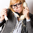 Businesswoman with three phones — Stock Photo