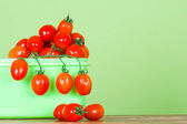 Container with fresh tomatoes — Stock Photo