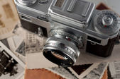 Camera and old photos close up. — Stock Photo