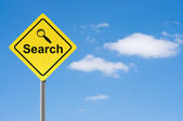 Sign search magnifier sky background. — Stock Photo