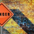 Traffic sign danger rusty wall. — Stockfoto