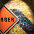 Traffic sign danger rusty wall background. — Stock Photo