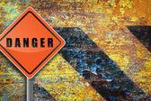 Traffic sign danger rusty wall. — Stock Photo