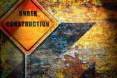 Roadsign under construction rusty wall. — Stock Photo