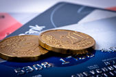 Credit cards and coins macro. — Stock Photo