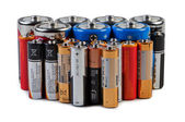 Batteries and accumulators on a white background. — Stock Photo