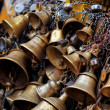 Many metal sacrificial bells hanging on chain, Kathmandu, Nepal - Stock Photo