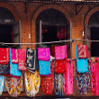 Stock Photo: Storefront of old nepal textile shop with many multicolored garm