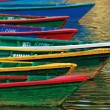 Color boats on Phewa lake, Pokhara, Nepal — Stock Photo