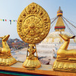 Golden brahma symbol in front of Boudha Nath (Bodhnath) stupa in - Stock Photo