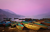 Beautiful twilight landscape with boats on Phewa lake, Pokhara, — Stock Photo