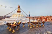 Many sacred candles in front of Boudha Nath (Bodhnath) stupa in — Stock Photo