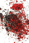 Red and black color crumbled eye shadows isolated on white — Stock Photo
