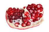 Juicy ripe open pomegranate piece isolated on white background m — Stock Photo