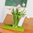 Bouquet of pink tulips flowers in glass vase on wooden table - Stock Photo