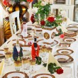 Luxuriant table appointments with red china porcelain and rose — Stock Photo