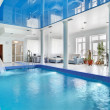 Indoor big blue swimming pool interior in modern minimalism styl - Stock Photo