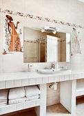 Part of modern bathroom interior with sink and mirror — Stock Photo