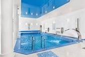 Indoor big blue swimming pool interior in modern minimalism styl — Stock Photo